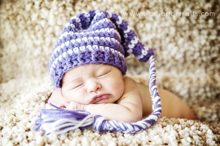 hand-crocheted hat on a baby